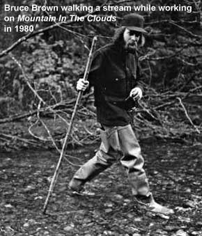 Bruce Brown walking a stream while working on Mountain in the Clouds in 1980 (Mary Randlett photo)
