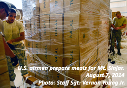American airmen prepare food for Mt. Sinjar refugees