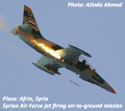 Syrian Air Force jet firing missles