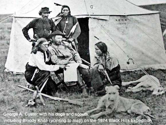 George A. Custer with scouts and dogs